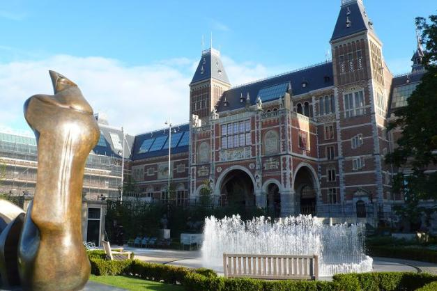 The Rijksmuseum as seen from the Rijksgardens with an exhibit of sculpures by England's Henry Moore.